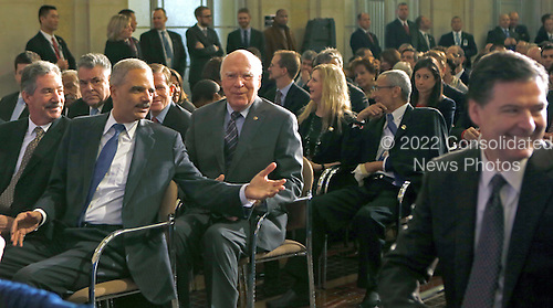 United States Deputy Attorney General James Cole, left; U.S. Attorney General Eric Holder, second left; U.S. Senator Patrick Leahy (Democrat of Vermont), Chairman of the U.S. Senate Judiciary Committee, second right; and Director of the Federal Bureau of Investigation (FBI), James Comey, right, engage in conversation prior to U.S. President Barack Obama's  remarks on signals intelligence programs and how they can be used to protect national security while supporting foreign policy and respecting privacy and civil liberties, at the Department of Justice in Washington DC, on January 17, 2014. Also visible in the photo at left is U.S. Representative Peter King (Republican of New York), Chairman, U.S. House Sub-Committee on Counterterrorism and Intelligence.<br /> Credit: Aude Guerrucci / Pool via CNP