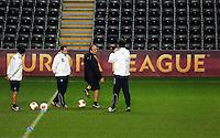 Napoli manager Rafa Benitez (3rd L) during training