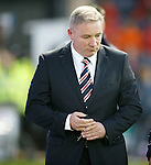 Ally McCoist with his lucky keys in hand walks along to take his place in the Rangers dugout