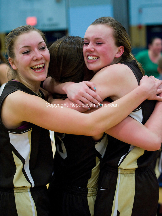 WATERBURY, CT-17 March 2014-031714EC04--   Thomaston's Morgan Sanson, Nicole Schaefer, and Gabby Hurlbert hug after their win over Sacred Heart at Kennedy High School Monday night. The Bears defeated the Hearts, 43-32. Erin Covey Republican-American