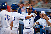 Dunedin Blue Jays Deiferson Barreto (15) congratulates Max Pentecost (10) on hitting a home run in the bottom of the fifth inning during a game against the St. Lucie Mets on April 20, 2017 at Florida Auto Exchange Stadium in Dunedin, Florida.  Dunedin defeated St. Lucie 6-4.  (Mike Janes/Four Seam Images)