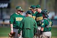 Siena Saints head coach Tony Rossi (40) talks with Brian Kelly (14), pitcher Dylan D'Anna (30) and catcher Alex Milone (10) during a game against the UCF Knights on February 17, 2019 at John Euliano Park in Orlando, Florida.  UCF defeated Siena 7-1.  (Mike Janes/Four Seam Images)