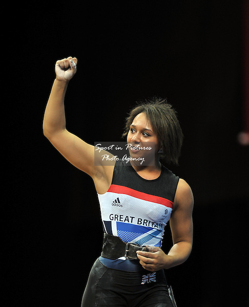 Zoe Smith (Great Britain) raises her arms to celebrate after setting a new British record - Womens weightlifting - 58kg Group B - PHOTO: Mandatory by-line: Garry Bowden/SIP/Pinnacle - Photo Agency UK Tel: +44(0)1363 881025 - Mobile:0797 1270 681 - VAT Reg No: 768 6958 48 - 29/07/2012 - 2012 Olympics - Aquatics Centre, London, England.