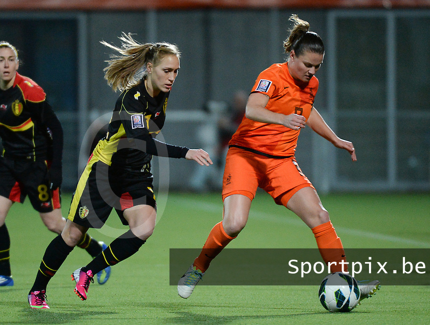 20140212 - ZWOLLE , THE NETHERLANDS : Dutch Sherida Spitse (r) pictured with Belgian Janice Cayman (l)  during the female soccer match between The Netherlands and Belgium , on the fifth matchday in group 5 of the UEFA qualifying round to the FIFA Women World Cup in Canada 2015 at Het Ijseldelta Stadion , Zwolle . Wednesday 12th February 2014 . PHOTO DAVID CATRY
