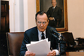 United States President George H.W. Bush delivers a radio address from the Cabinet Room of the White House in Washington, DC on April 17, 1992.  The address was not broadcast until April 18, 1992.<br /> Mandatory Credit: David Valdez / White House via CNP