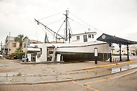 A fishing boat is washed ashore into the parking lot at Fisherman's Wharf during Hurricane Ike, Galveston, Texas