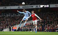 Leeds United's Patrick Bamford with a header towards goal under pressure from Arsenal's Rob Holding<br /> <br /> Photographer Rob Newell/CameraSport<br /> <br /> Emirates FA Cup Third Round - Arsenal v Leeds United - Monday 6th January 2020 - The Emirates Stadium - London<br />  <br /> World Copyright © 2020 CameraSport. All rights reserved. 43 Linden Ave. Countesthorpe. Leicester. England. LE8 5PG - Tel: +44 (0) 116 277 4147 - admin@camerasport.com - www.camerasport.com