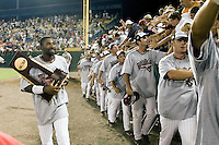South Carolina CF Jackie Bradley Jr carries the championship trophy following NCAA Division One Men's College World Series Finals on June 29th, 2010 at Johnny Rosenblatt Stadium in Omaha, Nebraska.  (Photo by Andrew Woolley / Four Seam Images)