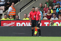 Match Referee Andy Davies shows Timm Klose of Norwich City a red card before changing his mind after talking to Assistant Referee during Norwich City vs Middlesbrough, Sky Bet EFL Championship Football at Carrow Road on 15th September 2018