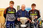 Dan O'Donoghue (Tralee) holding the cup with Killian Falvey and Colm Moriarty with the Tommy Markin Cup and the Munster Minor Cup at the Threshing Festival in Blennerville on Sunday.