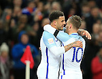 England's Kyle Walker celebrates with goalscorer Jamie Vardy during the International friendly match at Wembley.  Photo credit should read: David Klein/Sportimage