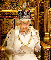 18 May 2016 - London England - Queen Elizabeth II reads the Queen's Speech from the throne during the State Opening of Parliament in the House of Lords in London. The State Opening of Parliament marks the formal start of the parliamentary year and the Queen's Speech sets out the government's agenda for the coming session. Photo Credit: ALPR/AdMedia
