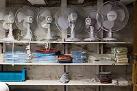 Desk fans stand on a shelf in the laundry area of the Harborside Inn in Edgartown, Martha's Vineyard, Massachusetts, USA.