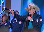 Billy Kidd shows the crowd his Olympic Silver medal during the Olympic Homecoming  Celebration at Squaw Valley on Friday night, March 21, 2014.