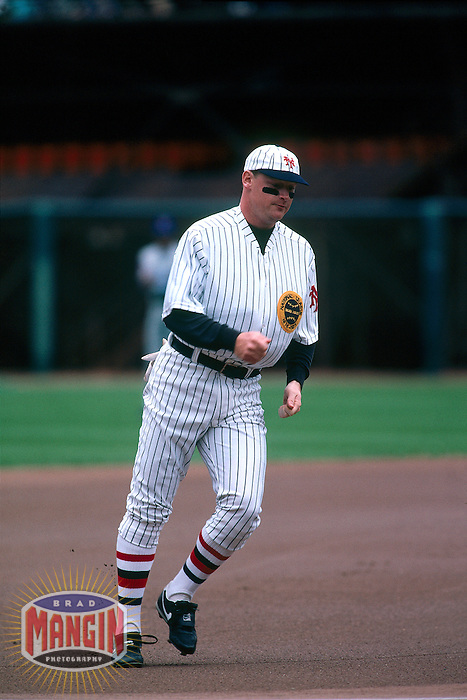 SAN FRANCISCO, CA - Matt Williams of the San Francisco Giants runs the bases dressed as Babe Ruth on Turn Back the Clock Day before a game at Candlestick Park in San Francisco, California in 1991. Photo by Brad Mangin