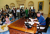 United States President Bill Clinton delivers his weekly radio address from the Oval Office of the White House in Washington, DC on August 7, 1993. In his address the President spoke about his economic plan that was passed by Congress.<br /> Credit: White House via CNP