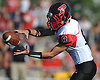 Mike Ciuffo #8, Plainedge quarterback, takes a snap during a Nassau County Conference III varsity football game against host Lawrence High School on Saturday, Sept. 23, 2017. He threw for four touchdowns, including the game-winner with 23.3 seconds left in the fourth quarter, to lead Plainedge to a 38-34 win.