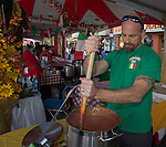 Jason stirs sauce in the Alessi-Artana booth during the 35th Annual Eldorado Great Italian Festival held in downtown Reno on Saturday, October 8, 2016.