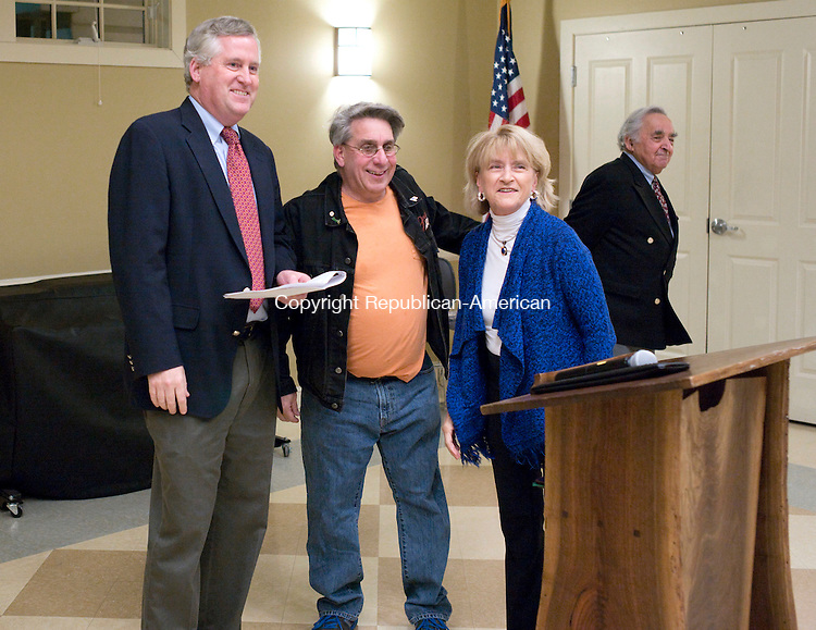 Woodbury, CT- 06 December 2015-120615CM19- From left, Woodbury town attorney, Thomas Kaelin swears in zoning board of appeals members, Joe Donato Jr. and <br /> Claudette Volage during a ceremony at the Woodbury Senior Center on Sunday.  27 town officials were sworn in ahead of the first meeting of the new Board of Selectmen, which will be held on Monday.   Christopher Massa Republican-American