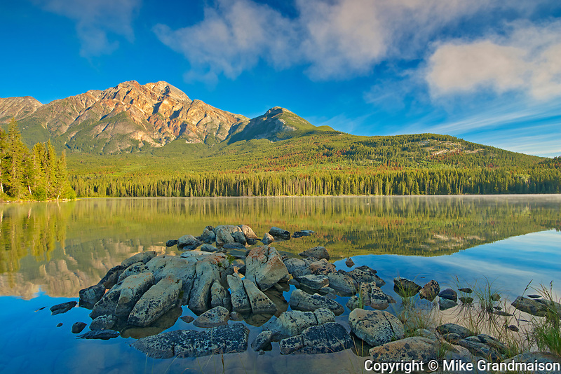 Pyramid Mountain and fog rising off Pyramid Lake <br />Jasper National PArk<br />Alberta<br />Canada