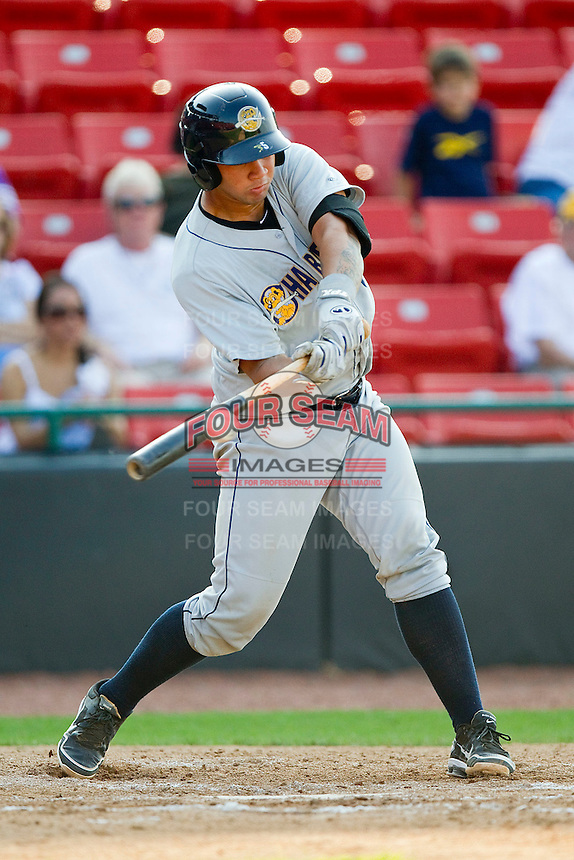 Gary Sanchez #35 of the Charleston RiverDogs makes contact with the baseball during the game against the Hickory Crawdads at L.P. Frans Stadium on April 29, 2012 in Hickory, North Carolina.  The Crawdads defeated the RiverDogs 12-3.  (Brian Westerholt/Four Seam Images)