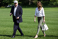 United States President Donald J. Trump and First Lady Melania Trump cross the South Lawn after arriving at The White House on June 18, 2017 in Washington, D.C. President Trump spent the weekend at Camp David.<br /> Credit: Zach Gibson / Pool via CNP /MediaPunch