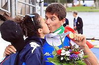 Marcello Miani of the Italian Lightweight Men's Single Sculls celebrates with her wife after winning the final event of the World Rowing Championships in Amsterdam, Netherlands, Friday August 29, 2014. - Photo by Paulo Amorim