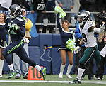 Seattle Seahawks Running back C.J. Prosise #22 outruns Philadelphia Eagles safety Rodney McLeod #23 for a 72-yard touchdown in the first quarter at CenturyLink Field in Seattle, Washington on November 20, 2016.  Seahawks beat the Eagles 26-15.  ©2016. Jim Bryant Photo. All Rights Reserved.