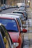 Densely parked cars in Codrington Hill, lewisham, London.