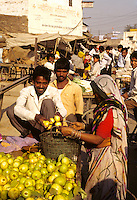 Shoppers in street market in Delhi India