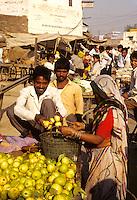Shoppers in street market in Delhi India