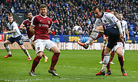 Northampton Town's Aaron Phillips blocks a cross form Bolton Wanderers' Adam Le Fondre<br /> <br /> Photographer Alex Dodd/CameraSport<br /> <br /> The EFL Sky Bet League One - Bolton Wanderers v Northampton Town - Saturday 18th March 2017 - Macron Stadium - Bolton<br /> <br /> World Copyright &copy; 2017 CameraSport. All rights reserved. 43 Linden Ave. Countesthorpe. Leicester. England. LE8 5PG - Tel: +44 (0) 116 277 4147 - admin@camerasport.com - www.camerasport.com