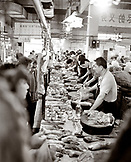 CHINA, Hangzhou, butchers sell meat at a market in Hangzhou (B&W)