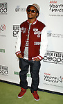 LOS ANGELES, CA. - February 05: Recording artist Lupe Fiasco arrives at the Black Eyed Peas Peapod Foundation benefit concert presented by Adobe Youth Voices inside the Conga Room at the Nokia Theatre L.A. Live on February 5, 2009 in Los Angeles, California.
