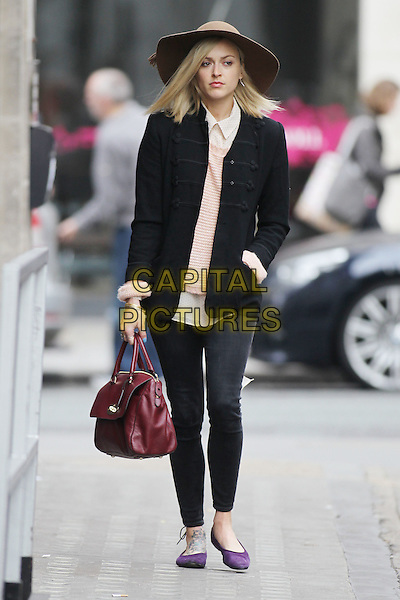 Fearne Cotton arriving at the studios of BBC Radio 1, London, England..March 18th, 2012.full length brown hat black blazer pink stripe top jeans denim purple shoes pumps red maroon burgundy bag purse hand in pocket striped stripes .CAP/HIL.©John Hillcoat/Capital Pictures.