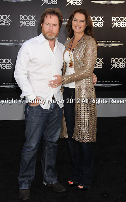 HOLLYWOOD, CA - JUNE 08: Brooke Shields and Chris Henchy arrive at the 'Rock Of Ages' - Los Angeles Premiere at Grauman's Chinese Theatre on June 8, 2012 in Hollywood, California.