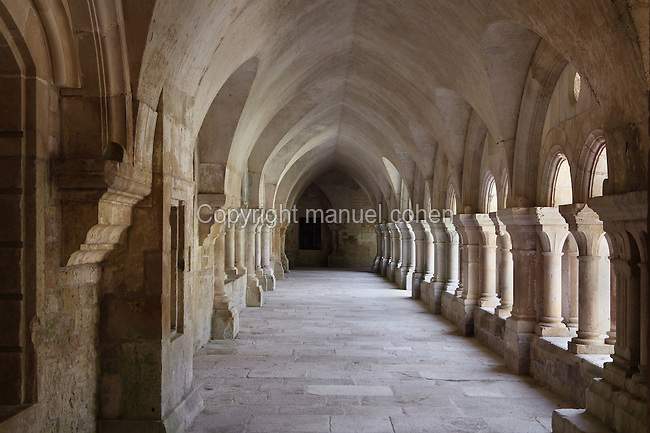Arcade of the cloister, Fontenay Abbey, Marmagne, Cote d'Or, France. This Cistercian abbey was founded by Saint Bernard of Clairvaux in 1119, built in the Romanesque style. The abbey itself housed 300 monks from 1200, but was sacked during the French Revolution. The 36m cloister was built in the 12th century, clustered pillar arches open to arcades on each side. Picture by Manuel Cohen