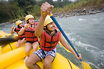 TURRIALBA, COSTA RICA- JANUARY 2, 2009:  Glenn Sáenz (R), 23, of Jersey City; and his cousins Gaby Quirós (C), 21, and Fernanda Obando (L), 20, of San Jose; white-water raft on the Pacuare River with Rios Tropicales on January 2, 2009 in Turrialba, Costa Rica.    (Photo by Michael Nagle)