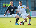 Dundee's Carlo Monti and Morton's Dougie Imrie challenge for the ball.