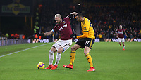 West Ham United's Marko Arnautovic and Wolverhampton Wanderers' Romain Saiss<br /> <br /> Photographer Rob Newell/CameraSport<br /> <br /> The Premier League - Wolverhampton Wanderers v West Ham United - Tuesday 29th January 2019 - Molineux - Wolverhampton<br /> <br /> World Copyright © 2019 CameraSport. All rights reserved. 43 Linden Ave. Countesthorpe. Leicester. England. LE8 5PG - Tel: +44 (0) 116 277 4147 - admin@camerasport.com - www.camerasport.com