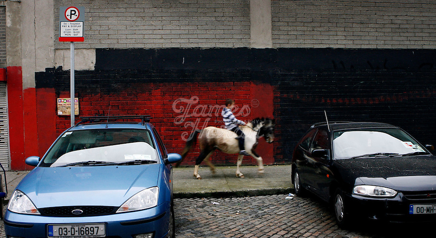 The monthly Smithfield Horse market is one of Dublin's oldest traditions. It is a place where kids from deprived areas of the city buy and sell horses. In recent years the Smithfield area has been redeveloped which creates a striking contrast to the horsemarket, The introduction of The Control of Horses Act has effectively outlawed these kids, and the closure of the market is a real possibility.