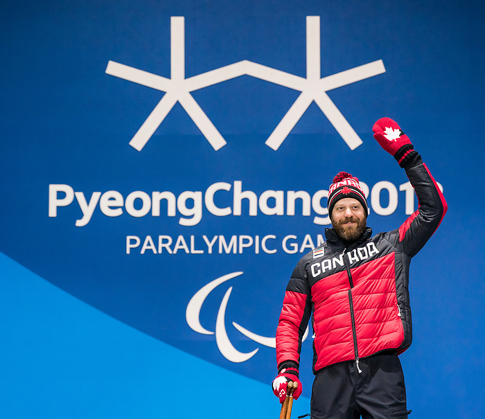 PyeongChang 11/3/2018 - Kurt Oatway collects his gold medal in the men's sitting super-G during the medal ceremony at the PyeongChang Olympic Plaza during the 2018 Winter Paralympic Games in Pyeongchang, Korea. Photo: Dave Holland/Canadian Paralympic Committee