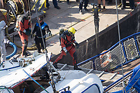 Rescue personnel move on board the passenger boat Hableany (means Mermaid in Hungarian) lifted up from the river after it's capsize in an accident on river Danube in downtown Budapest, Hungary on June 11, 2019. ATTILA VOLGYI