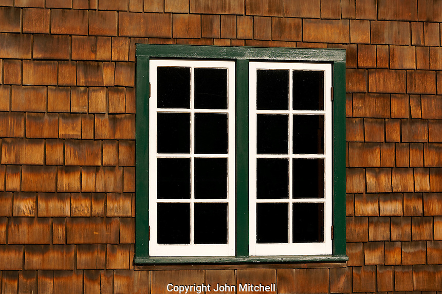 Glass paned widows in a cedar shake building, La Conner, Washington state, USA