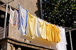 Wäscheleine, Clothes line, Omisalj ist eine kleine Küstenstadt im Nordwesten der Insel Krk, Kroatien. Die Bevölkerungsanzahl der Stadt selber beträgt 1.790 (2001). Omisalj ist eine der ältesten Städte von Krk. Sie wurde im 3. Jahrhundert von den Römern als Fulfinium gegründet. Omisalj is a small coastal town in the north-west of the island of Krk in Croatia. The population of the town itself is 1,790 (2001)..Omisalj is one of the oldest towns on Krk, dating from the 3rd century, Krk Island, Dalmatia, Croatia. Insel Krk, Dalmatien, Kroatien. Krk is a Croatian island in the northern Adriatic Sea, located near Rijeka in the Bay of Kvarner and part of the Primorje-Gorski Kotar county. Krk ist mit 405,22 qkm nach Cres die zweitgroesste Insel in der Adria. Sie gehoert zu Kroatien und liegt in der Kvarner-Bucht suedoestlich von Rijeka.