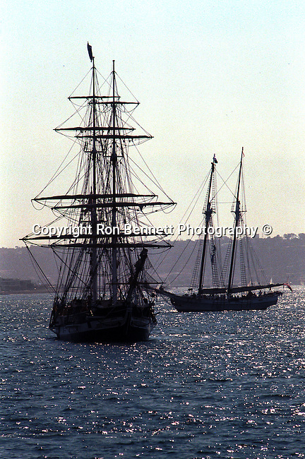 Silhouette of Schooner America  anchored in San Diego bay California, Schooner America, schooner, San Diego Bay California, tall ship, full rigged ship named after the Greek goddess of music, tall ship is large traditionally rigged sailing vessel, topsail, schooners, California Fine Art Photography by Ron Bennett,