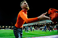 Oli McBurnie of Swansea City gives his shirt to a fan at full time during the Sky Bet Championship match between Brentford and Swansea City at Griffin Park, Brentford, England, UK. Saturday 08 December 2018