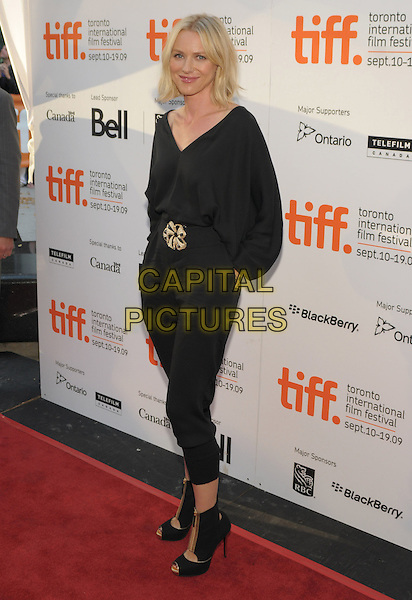 NAOMI WATTS .'Mother And Child' Premiere held at Roy Thomson Hall during the 2009 Toronto International Film Festival,  Toronto, Ontario, Canada, 14th September 2009..full length catsuit jumpsuit waist belt buckle gold v-neck  dress hand in pocket open toe ankle boots heels zips zip up shooboots shoe .CAP/ADM/BPC.©Brent Perniac/Admedia/Capital Pictures