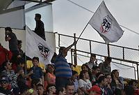 BOGOTA - COLOMBIA -16 -04-2016: Hinchas de Fortaleza animan a su equipo durante el partido entre Fortaleza FC y Cortuluá por la fecha 13 de Liga Águila I 2016 jugado en el estadio Metropolitano de Techo en Bogotá./ Fans of Fortaleza cheer for their team during the match between Fortaleza FC and Cortulua for the date 13 of the Aguila League I 2016 played at Metropolitano de Techo stadium in Bogota. Photo: VizzorImage / Gabriel Aponte / Staff.