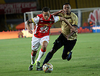 BOGOTA - COLOMBIA - 8-08-2015: Luis Seijas jugador de Independiente Santa Fe  disputa el balon con Hilton Murillo de Aguilas Doradas  durante partido  por la fecha 5 de la Liga Aguila II 2015 jugado en el estadio Nemesio Camacho El Campin. / Luis Seijas player of Independiente Santa Fe   fights the ball against Hilton Murillo  of Aguilas Doradas during a match for the fifth date of the Liga Aguila II 2015 played at Nemesio Camacho El Campin stadium in Bogota city. Photo: VizzorImage / Felipe Caicedo / Staff.